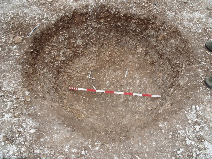 These remains were originally excavated from a network of 56 pits in the 1920s, placed around the inner circumference and ditch of Stonehenge, known as 'Aubrey Holes' (pictured)