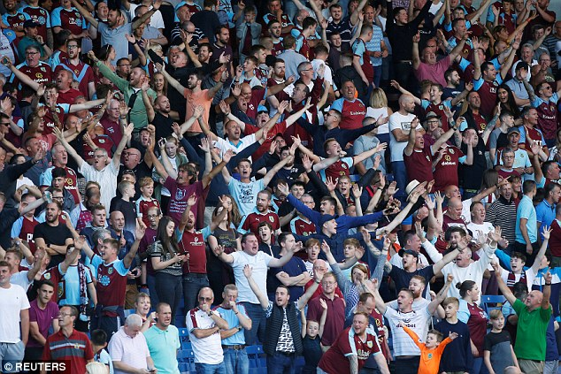 Burnley supporters celebrate following their side's victory over Aberdeen on Thursday