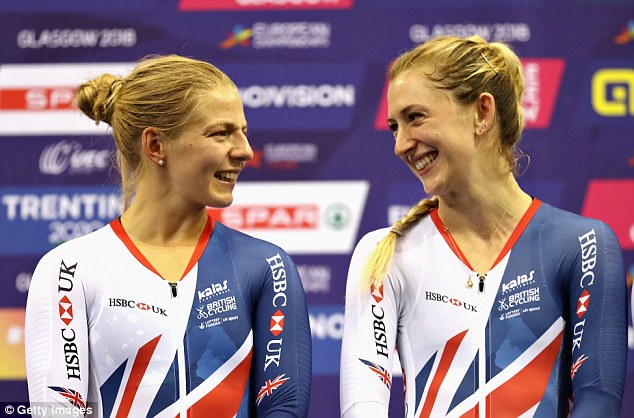 Kenny (right) laughs with team-mate Evans after winning the gold medal in Glasgow
