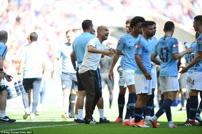 Guardiola took advantage of the hydration break in the first-half to pass on instructions to his players from the touchline