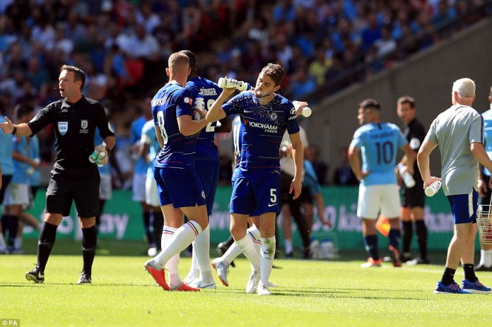 Chelsea's new midfield signing Jorginho has a drink as the mercury soared above 30C on a scorching day at Wembley