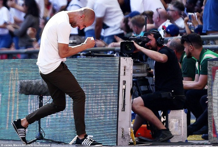 Guardiola celebrates on the Wembley sidelines after Aguero doubled his team's lead in the Community Shield