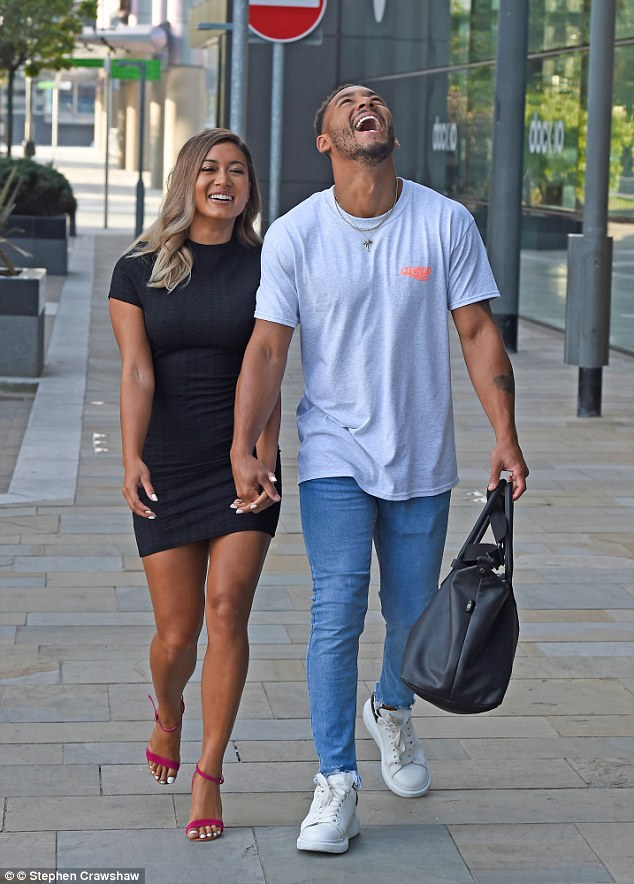 Jovial: The couple looked to be in good spirits as they left the BBC studios, with Josh looking casual in a grey t-shirt and jeans