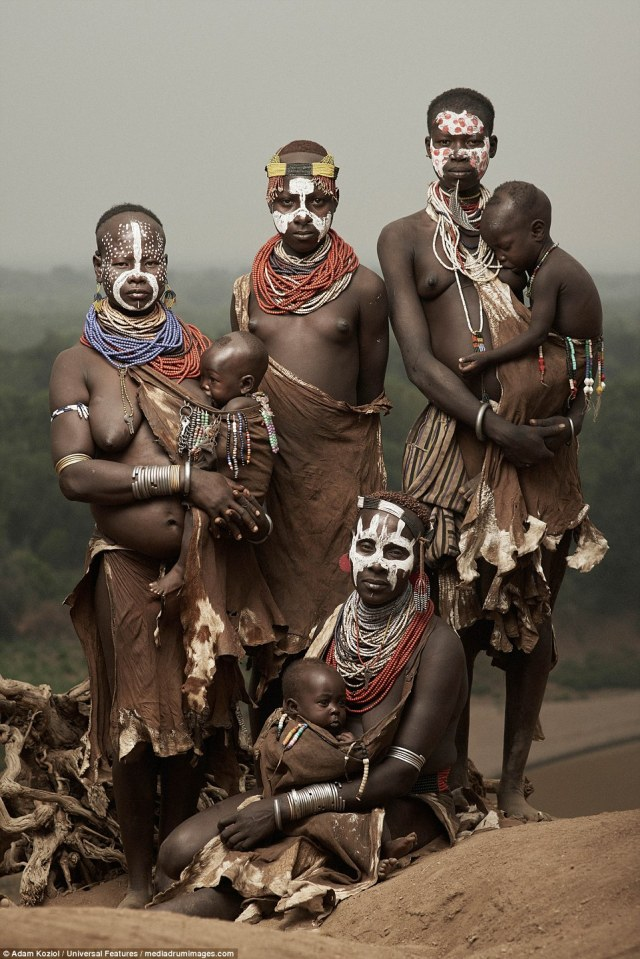 Stunning: Women on Ethiopia's Karo people, with white clay paint on their faces and labret piercings
