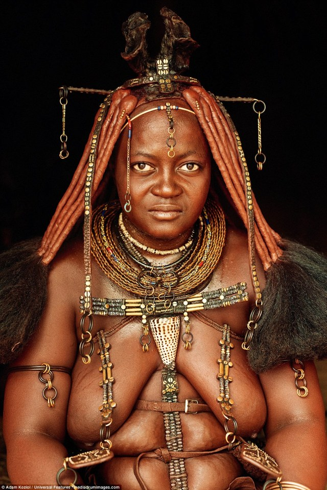 Hidden beauty: A woman from the Himba tribe, who live in northern Namibia. From puberty Himba women braid their hair and veneer each one with clay and red soil, and use the same mixture to paint their bodies red