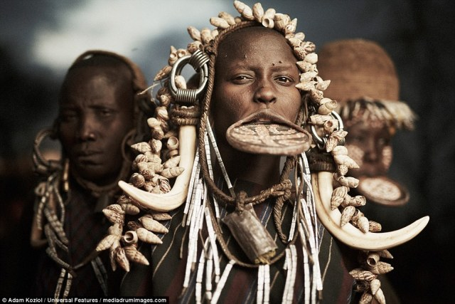 Female members of Ethiopia's Mursi tribe, which number less than 10,000, wear large clay discs in their lower lips