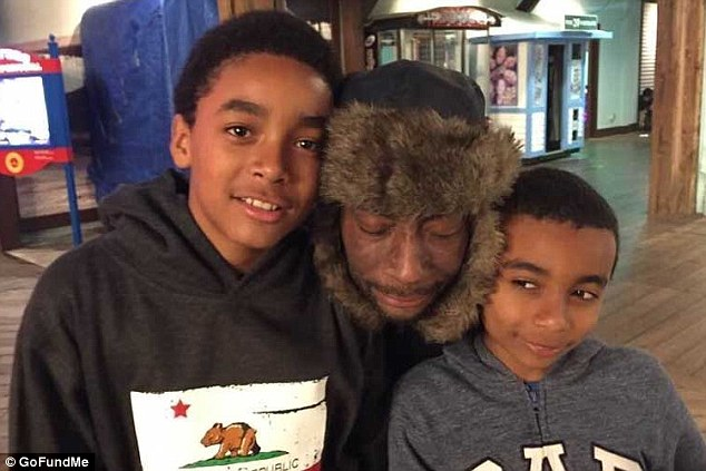 Johnson (pictured, with his sons) said he sprayed hundreds of gallons of the product between 30 and 40 times per year and was allegedly drenched in it repeatedly