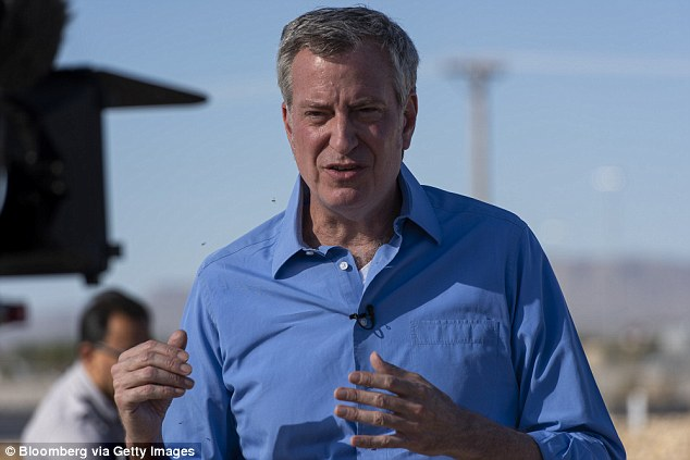The legislation will now go before Mayor Bill de Blasio, also a Democrat, who is expected to sign it. De Blasio is seen above in Tornillo, Texas in June