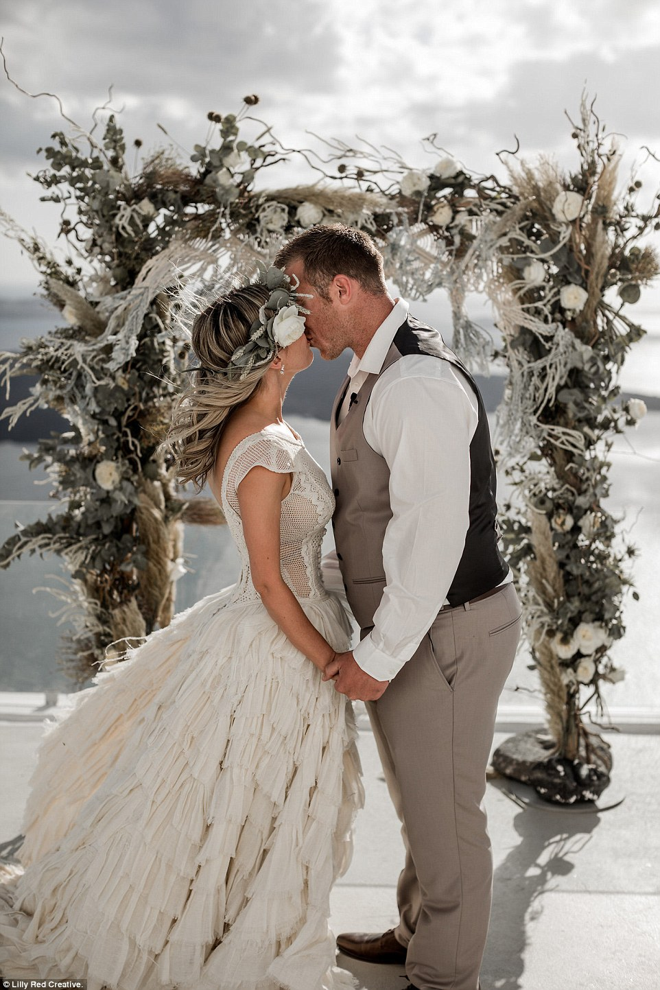Nicole and Michael Clayworth (pictured), from Port Macquarie, decided to abandon a big white wedding at home in Australia, and instead elope to Santorini to tie the knot while backpacking