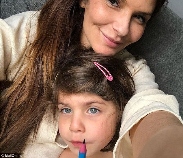 Dr Ellie Holman and her daughter Bibi, four, both pictured, were held in a Dubai jail cell for three days after she was arrested for drinking wine on an Emirates flight from the UK