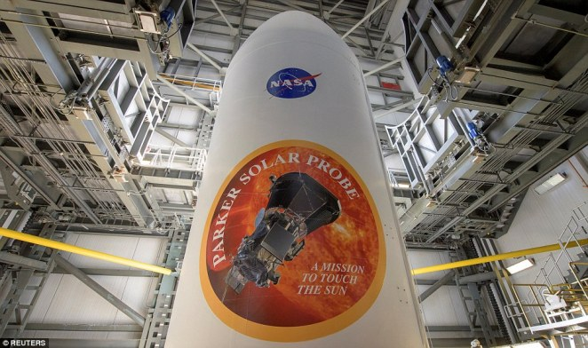 The Parker Solar Probe will launch from Cape Canaveral Saturday morning atop a ULA Delta IV Heavy, already one of the most powerful rockets in the world, with a third stage attached. Above, the massive rocket payload fairing can be seen with the mission emblems