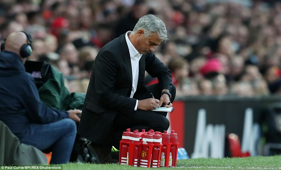 United manager  Mourinho - unhappy with the club's summer transfers - makes notes after his team started perfectly