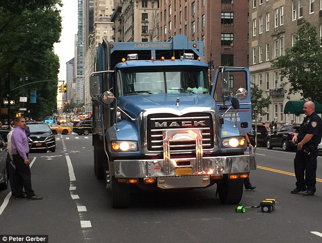 The driver of the car and the truck both remained at the scene to give NYPD officers their statements while the NYPD's Collision Investigation Squad investigated