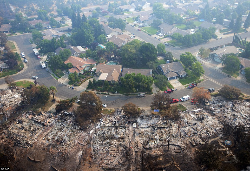 The devastation of the Carr Fire is seen near Redding in another northern California wildfire on Friday
