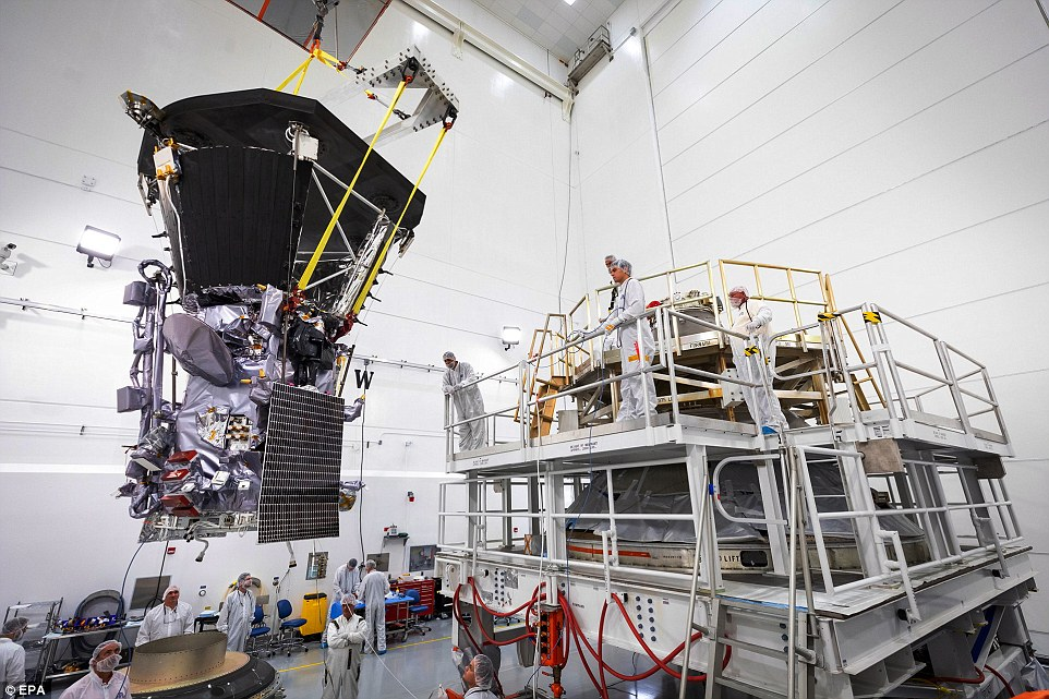Roughly 1,400 pounds of solar projection and science equipment are protected by an advanced heat shield, which uses a 4.5-inch thick carbon composite foam material between two carbon fiber face sheets. The probe can be seen above as it was lifted onto the third stage rocket motor