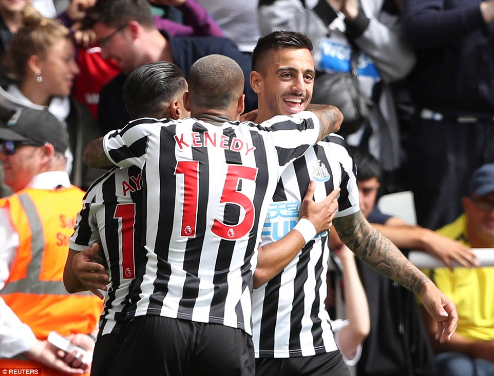 Joselu celebrates with his Newcastle team-mates after equalising against Tottenham early on in Premier League fixture