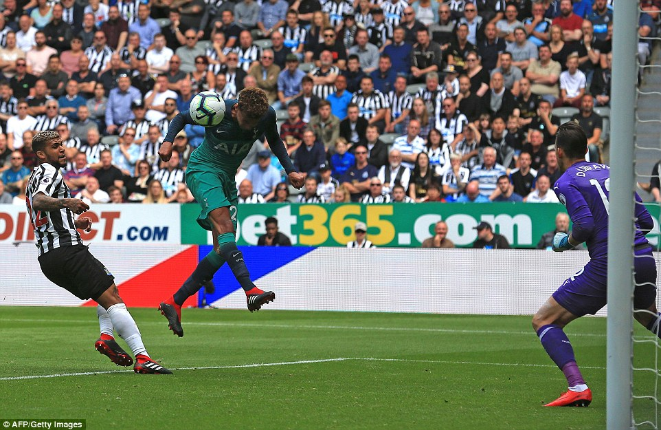 Alli heads the ball to put Tottenham back in front against Newcastle in the Premier League clash atSt James' Park