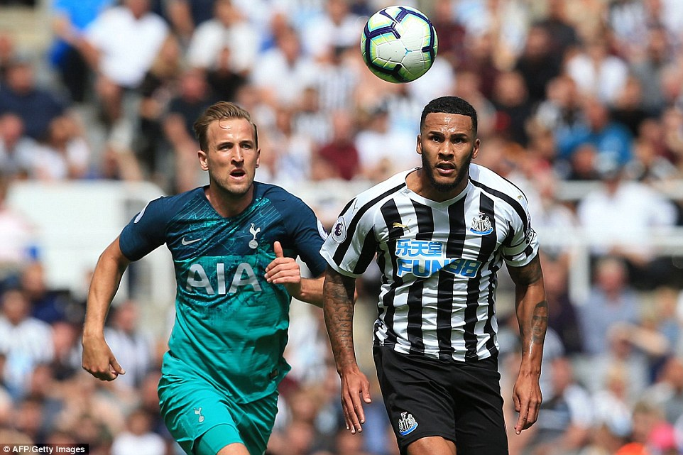Tottenham's English striker Kane (L) vies with Newcastle's English defender Jamaal Lascelles during the clash on Saturday