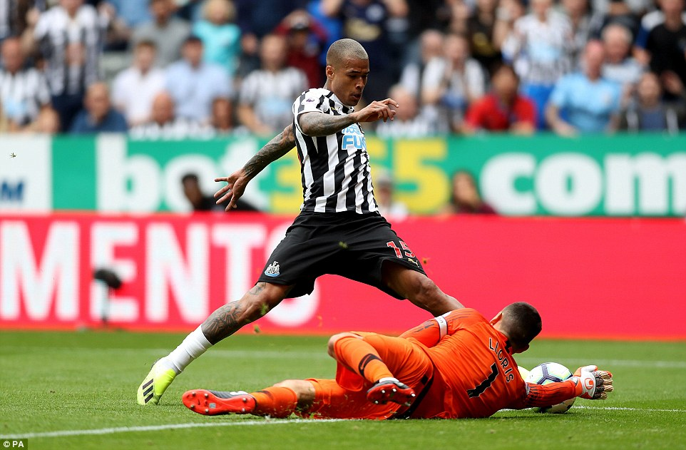 Tottenham goalkeeper Hugo Lloris dives to take the ball from Newcastle's Kenedy after he was clear through on goal