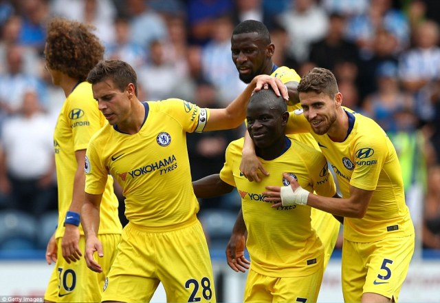 Chelsea players celebrated their opening goal after N'Golo Kante snuck to the back post and volleyed in from close