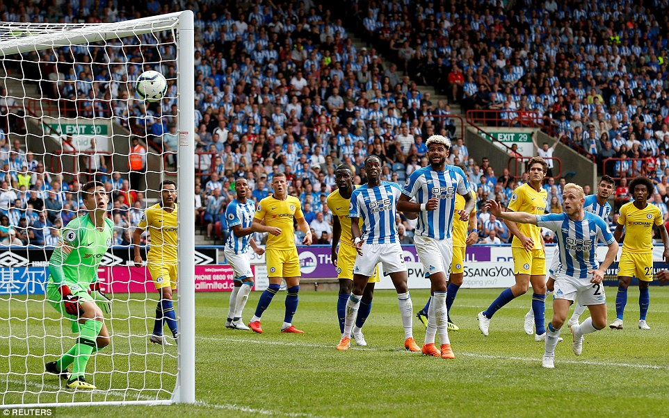Huddersfield'sSteve Mounie almost got them back on level terms but his header struck the inside the post and came out