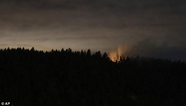 Smoke and an orange glow are seen on Ketron Island in Washington state, where the plane eventually crash landed