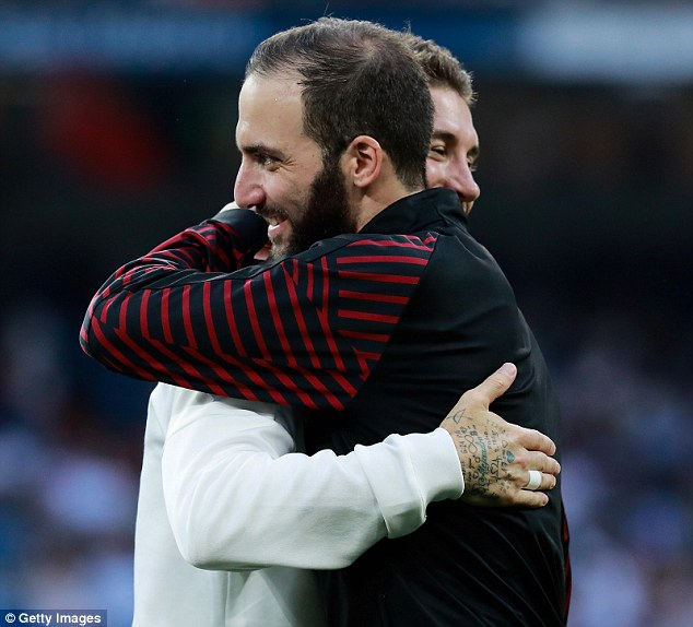 The pre-season match saw Higuain reuinte with former team-mates and hugged Sergio Ramos