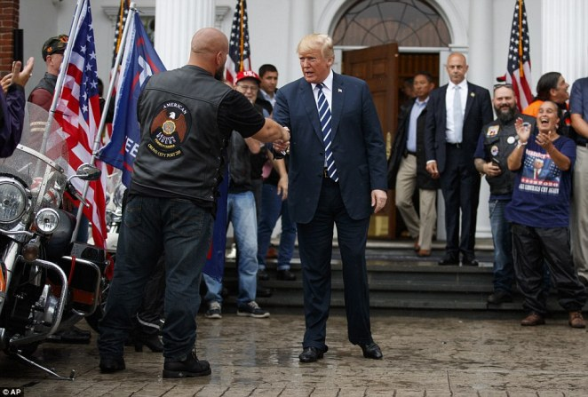 President Donald Trump greets cheering members of Bikers for Trump and supporters on Saturday