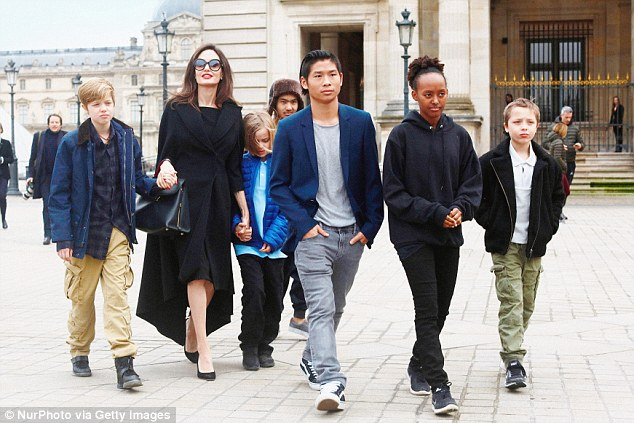 The source added: 'It's no secret that Angie would like to get full custody of the children and move abroad. Although she has physical custody, she can't move without Brad's consent.' Pictured: Angelina with, from left, children Shiloh, Vivienne, Maddox, Pax, Zahara, and Knox