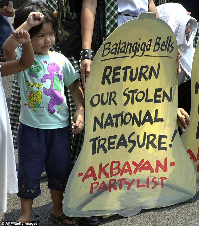 Duterte and previous Philippine governments had urged Washington to return the bells, with the president often raising the issue in his anti-American tirades as he builds closer ties with China and Russia. A little girl participates in a protest for the bells in September 2004
