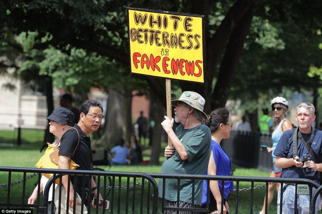 Counter-demonstrators begin to assemble in Lafayette Park rally across from the White House ahead of the planned white supremacist Unite the Right rally