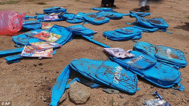 Heartwrenching: Bloodied children's UNICEF backpacks lie at the site after the airstrike