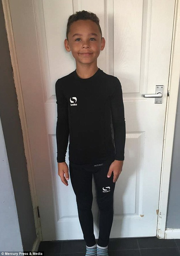 Fabian Butler, eight, from Gwent (pictured at home) began dressing up as a drag queen aged four or five. His mother Rachel recalled: 'He would put my shoes on and walk around and play in them. I thought it was a phase he would grow out of'