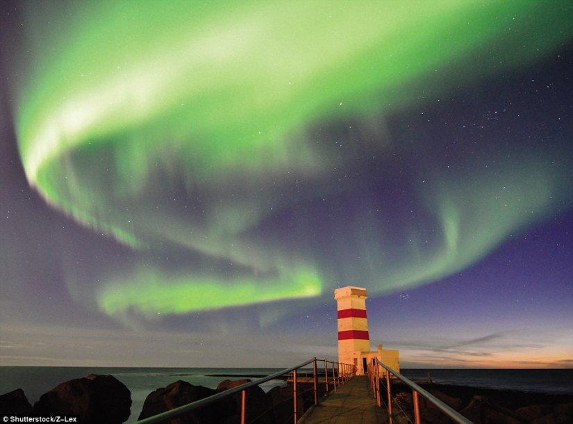 The Aurora Borealis is often seen above the Garðskagi Old Lighthouse in Iceland, a square concrete structure 41ft tall that was built in 1897. Its light system was transferred into a new, taller tower close by, built in 1944