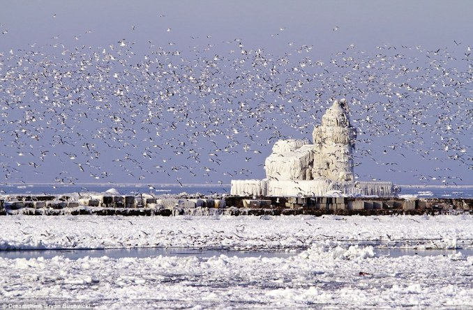 The harbour light at West Pierhead Lighthouse in Cleveland Harbour in Ohio was first installed in 1931. This image shows winter ice cloaking the cast-iron lighthouse, built in 1911 to guide ships from Lake Erie into the Port of Cleveland and the Cuyahoga River. It is now out of commission