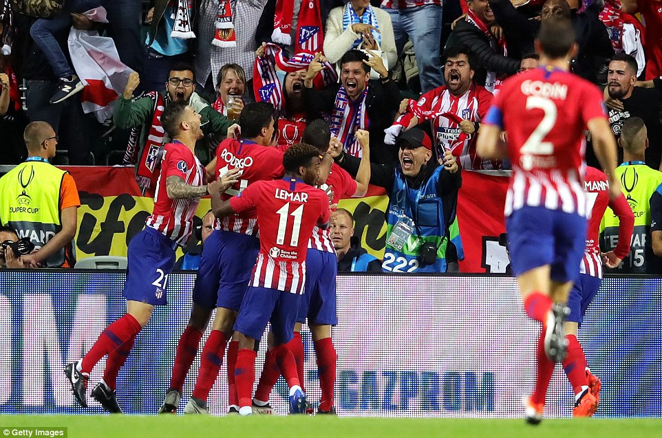 Costa is surrounded by his team-mates as they celebrate going 1-0 up in the UEFA Super Cup final against Real Madrid