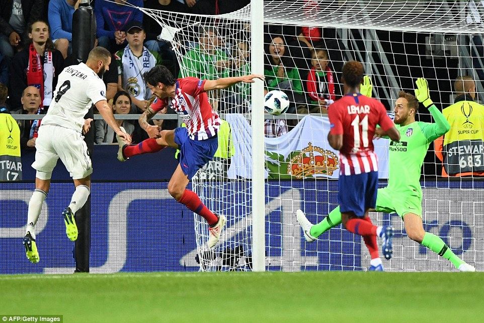 Real Madrid's forward Karim Benzema (left) equalises in the 27th minute of the UEFA Super Cup final  on Wednesday night