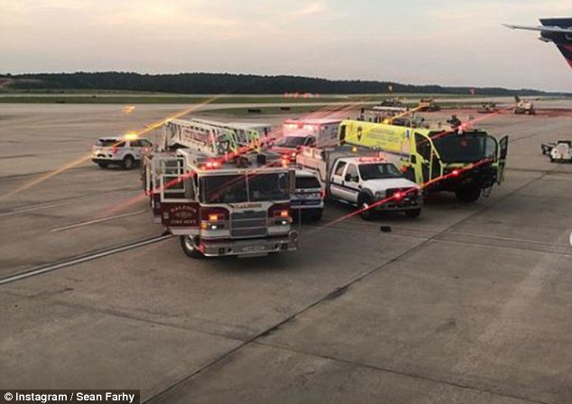 Eight people on board including one attendant complained of illness and three were taken for treatment. Pictured: Firetrucks on the runway