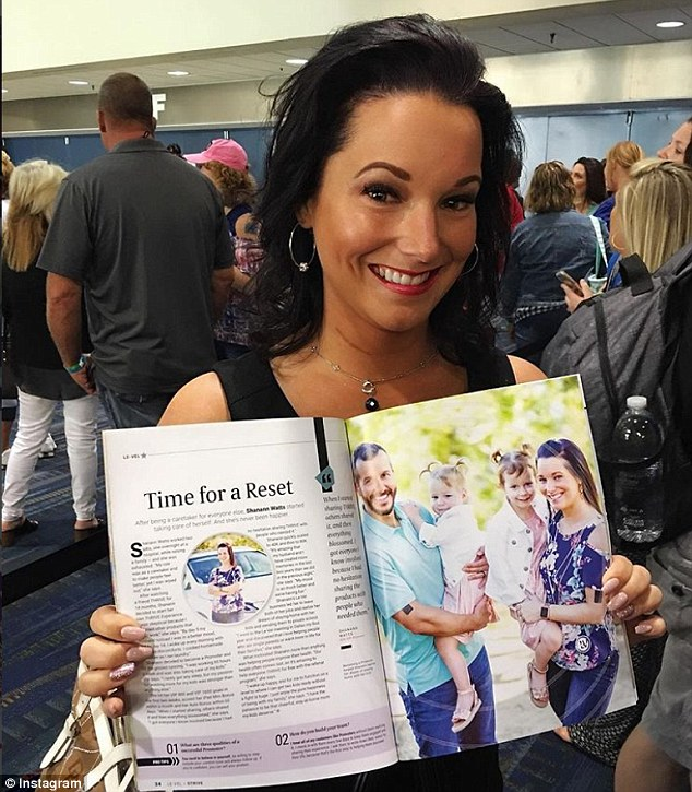 Shanann poses with a magazine spread featuring her family in May. It's not clear what the publication is, but it likely had to do with job selling health supplements