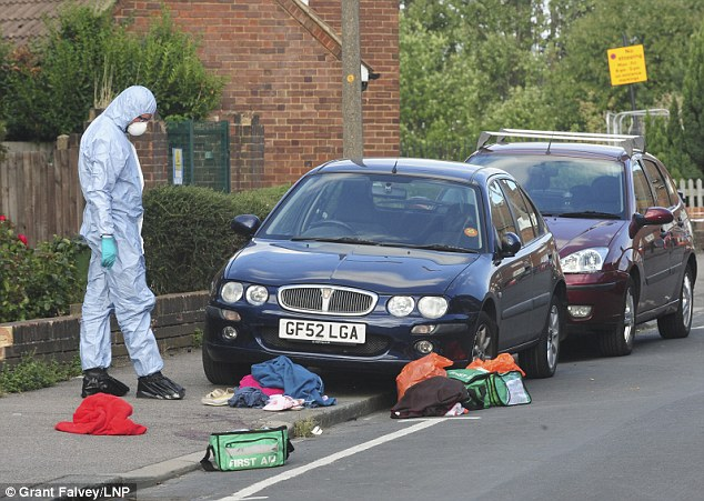 Pictured: Forensic officers on the scene in southeast London. Another neighbour said she is 'in complete shock' and is scared for her safety after the attack