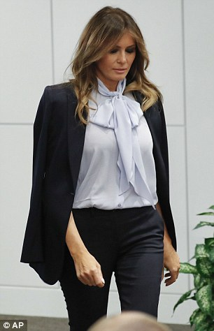 Top: She wore a pale blue blouse featuring a pussy bow tied around her neck, a style she has been known to enjoy since she wore it to a presidential debate in October 2016