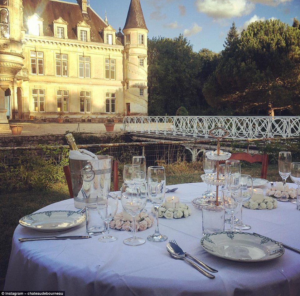 Sunset al fresco dining: Dinner is served in the stunning grounds of the Château de Bourneau in Vendee, Pays de la Loire. The French castle was recently purchased by Jean-Baptiste Gois and Erin, who met as students living in Edinburgh.Jean-Baptiste said: 'Initially, we did not consider buying a castle at all. The idea came to us as we went along'
