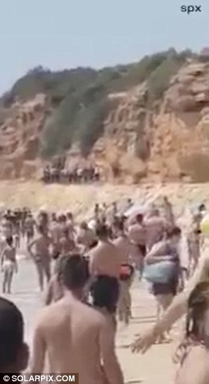 Holidaymakers watched open-mouthed as the semi-inflatable Zodiac carrying nearly 50 Moroccans including about ten children beached near a luxury hotel area on Spain's Costa de la Luz