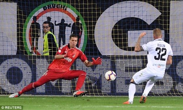 Luca Rigoni is denied by a superb point-blank save from keeper Wojciech Szczesny