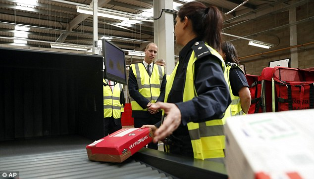 William watches as a UK Border Force officer scans via an X-Ray machine incoming mail and parcels