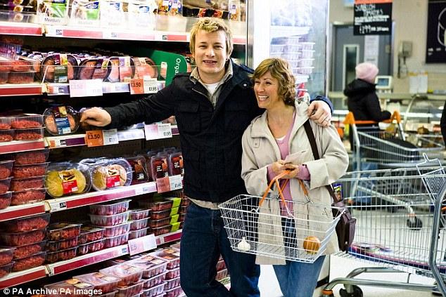 Le contrat d'Oliver avec Sainsbury's (photo), qui a pris fin en 2011, est considéré comme l'un des partenariats de célébrités les plus réussis du secteur et on pense qu'il lui a rapporté plus d'un million de livres par an.