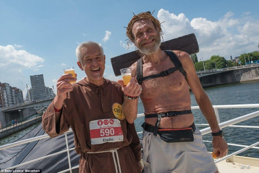 Two runners toast their endeavour at one of the 15 stops on the 26-mile course. The 15 beers available to sample are all from Belgium