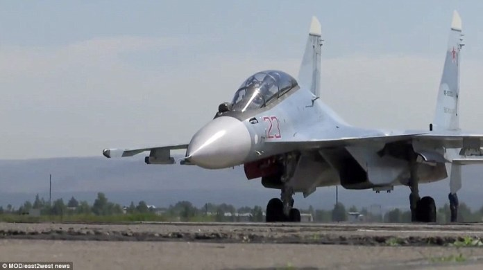 The week-long war games dubbed'Vostok-2018' (East-2018), kicked off in far eastern Russia. Pictured, a military aircraft getting into position on Tuesday