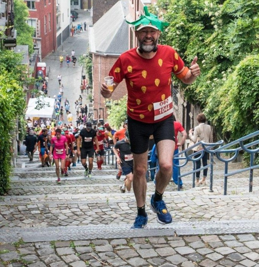 Stepping to it: Complete with a beer in hand, a runner is photographed at one of the early uphill sections