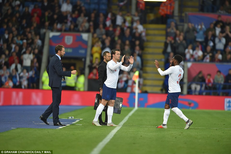 Ben Chilwell (centre) made his England debut late on as the young left back replaced Danny Rose